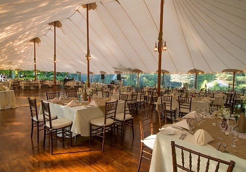 Wedding reception under a sailcloth tent at Clay Hill Farm
