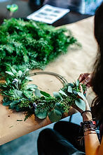 hand building leaf and pine wreath, photo by hillary ungson