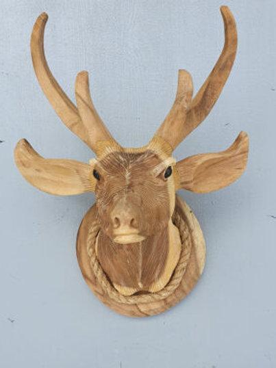 Deer head handmade from Suar wood.