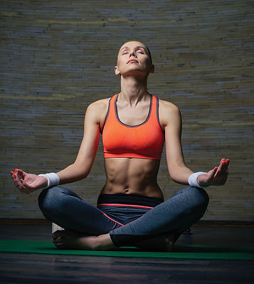 Woman in meditation pose with legs crossed