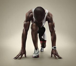 Black man in sprinting position