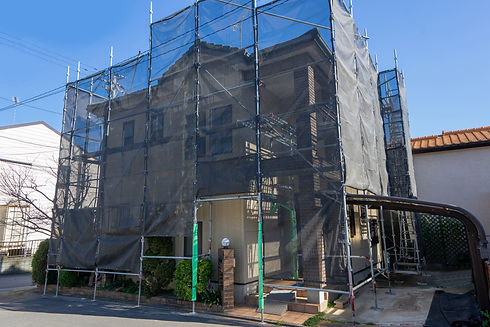 Exterior wall painting work.Scaffolding,