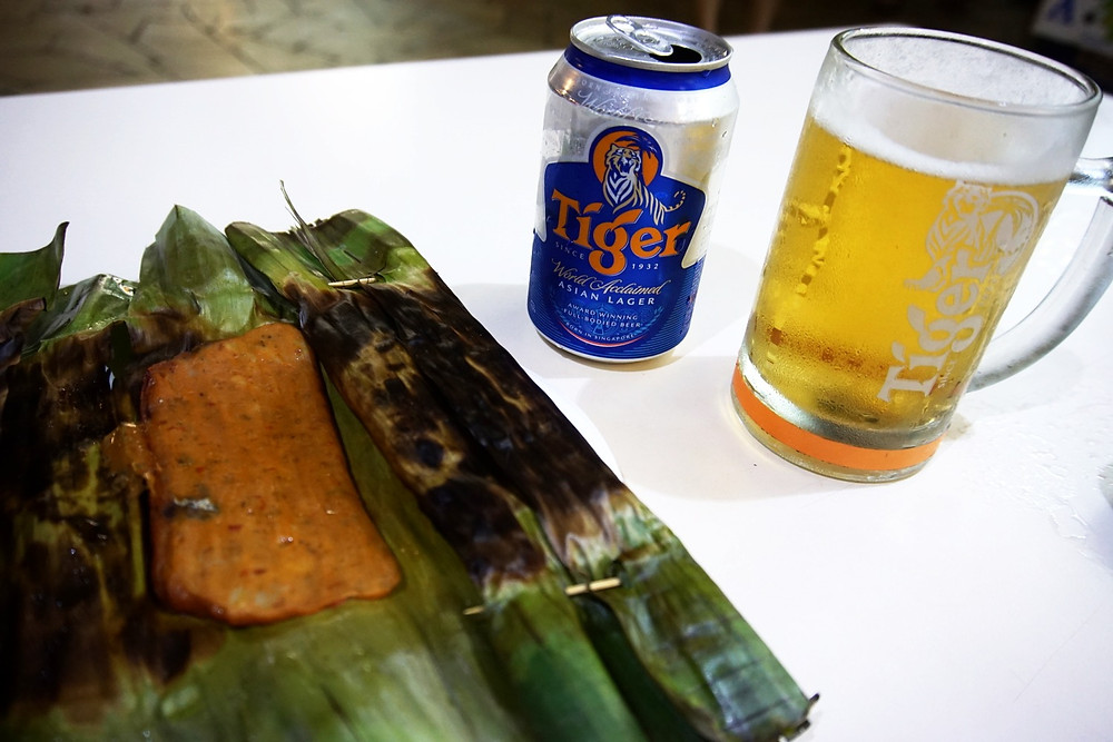Fish cake came presented in a leaf, my husband got a Tiger beer