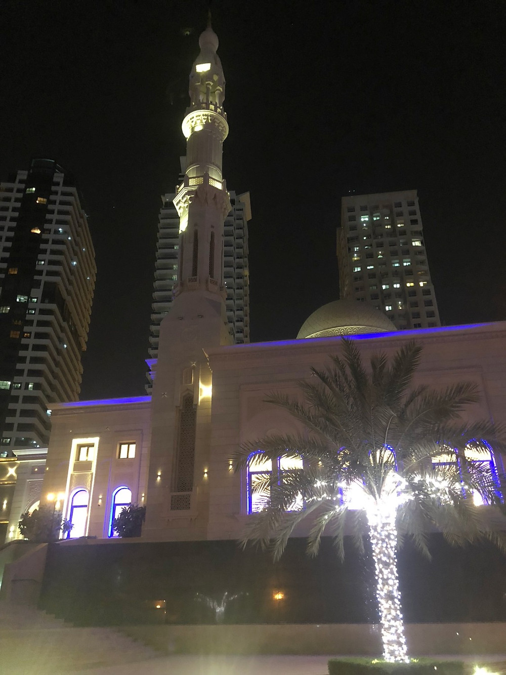 The same mosque lit up at night