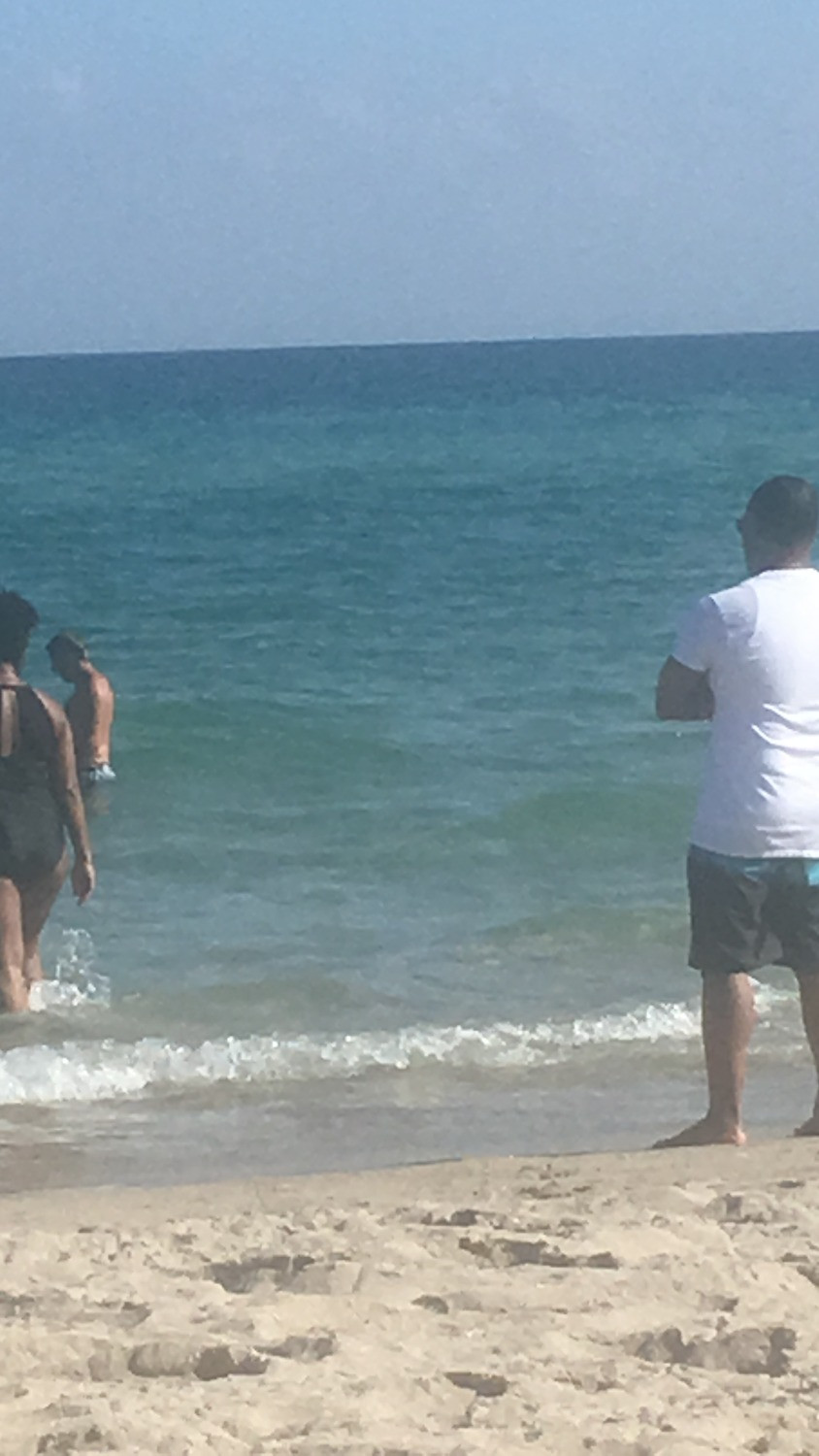 Hubby watching as I brave the cold water