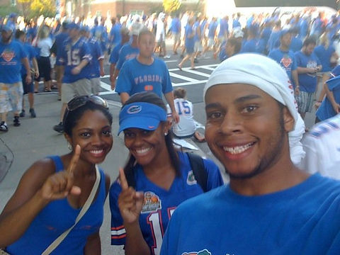 My brother and sis in law celebrating outside The Swamp in Gainesville, Florida after a victory