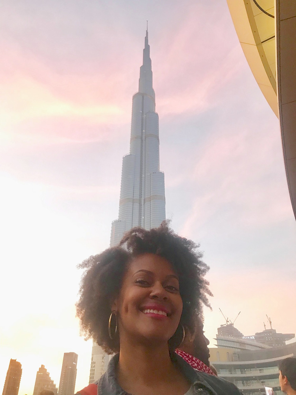 Back on the ground, posing in front of the Burj Khalifa