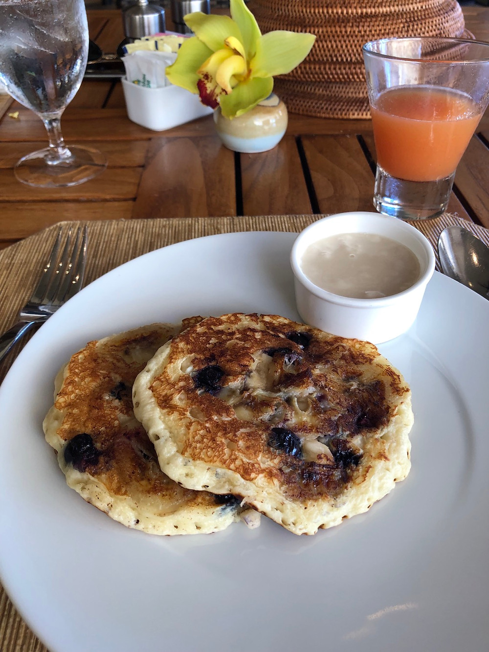 Made to order banana, blueberry and macadamia nut pancakes with coconut syrup