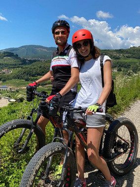 Couple rides bike Italy