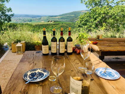 Wooden table with wines