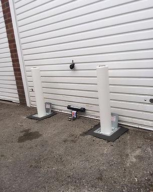white telescopic bollards with  door deffender