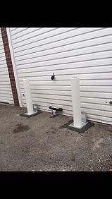 telescpic post with a garage door defender