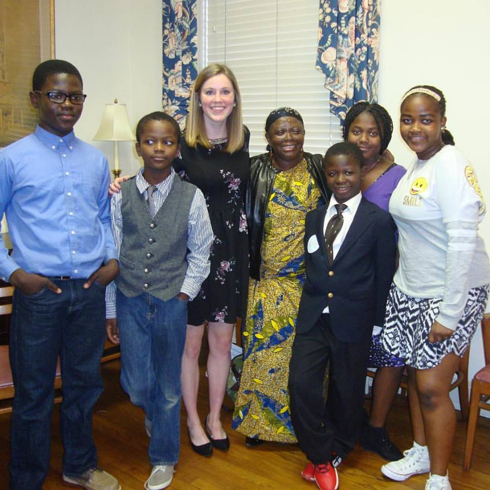 Berthe and her five children take a picture with Molly, Moustapha's Musical Empowerment piano teacher.