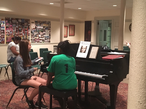 "Taniya and her piano teacher, Marissa, practice playing ""Hello"" for the recital."