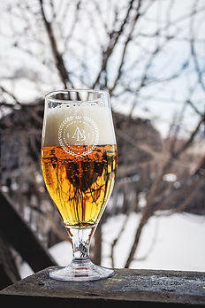 A glass of beer with logo Aftograf Vkusa by ZBS BRANDS.