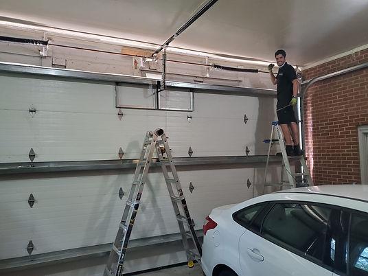Danny working on a garage door.jpeg