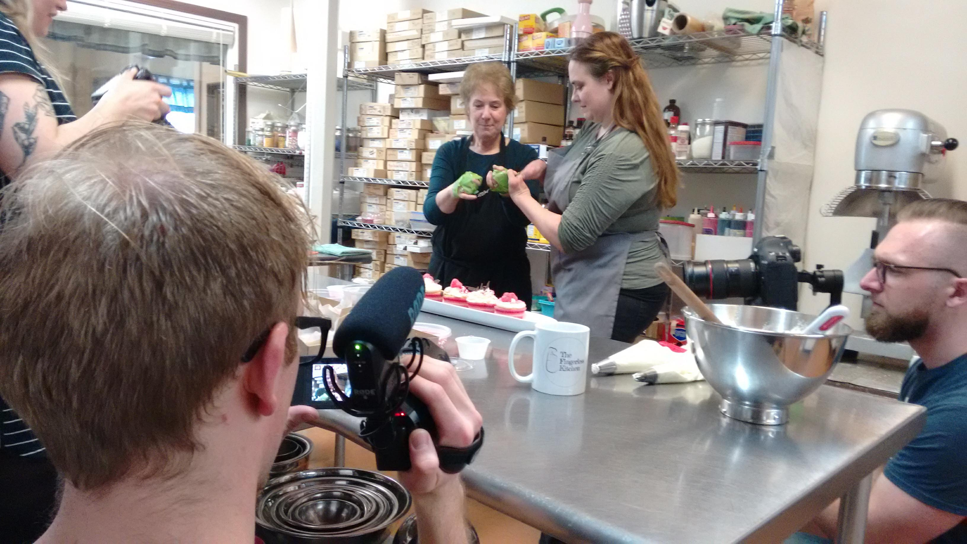 Cameras and crew behind the scenes in the kitchen of Halfmoon Bakery