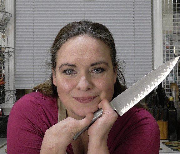 Bryony holding a chefs knife