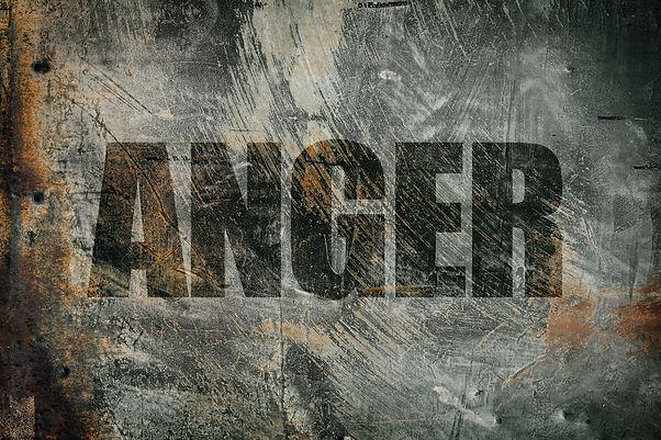 Anger written on steel background.jpg