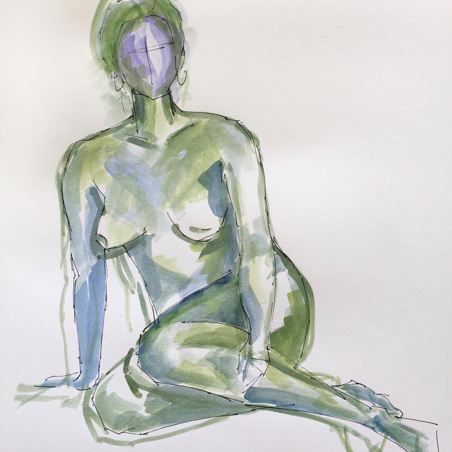 Woman in green seated
