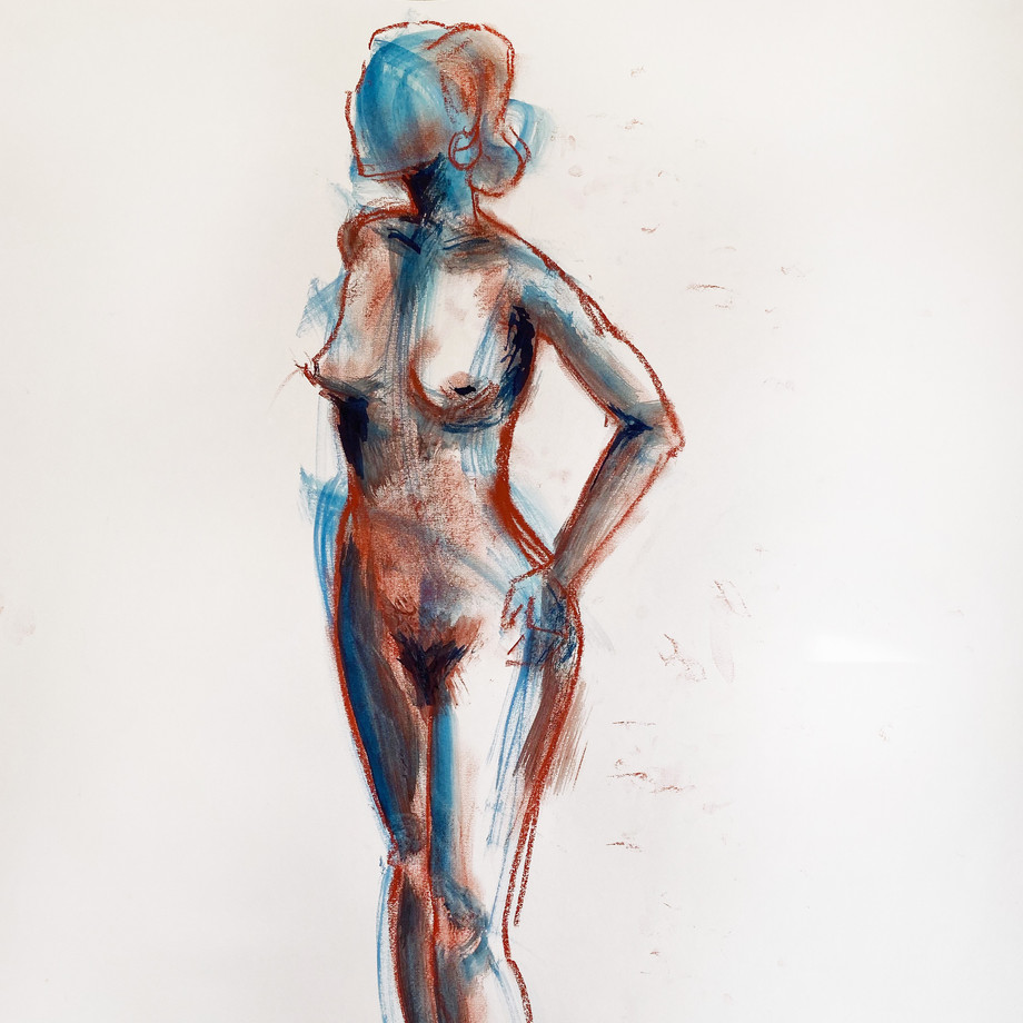 Woman in blue standing