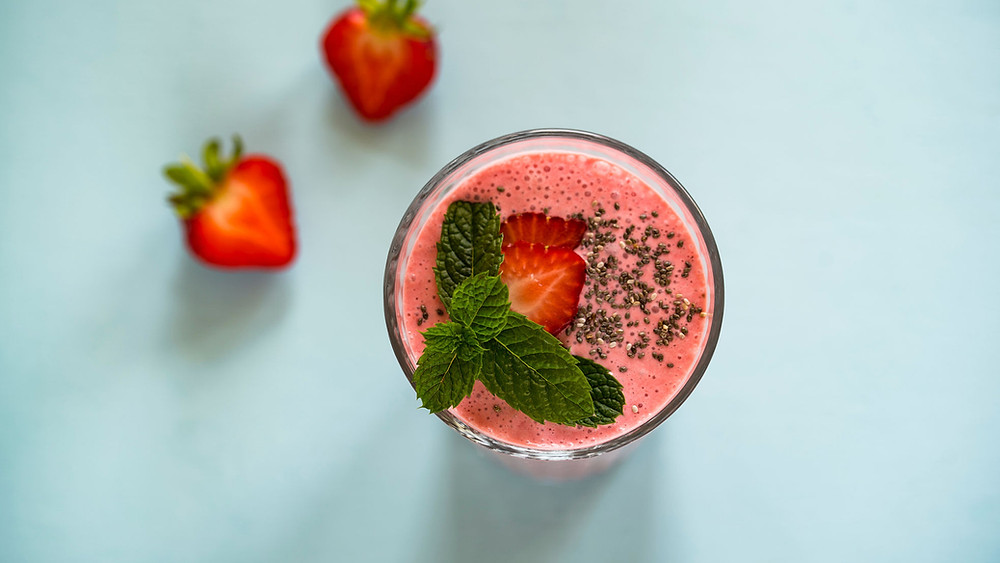Strawberry smoothie, chia seeds, mint leaf, fresh fruits
