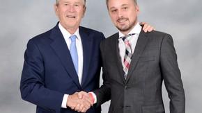 安排客户拜访小布什总统