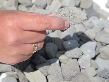 Hand holding foamed glass aggregate