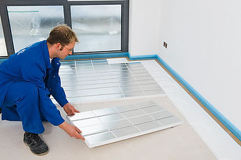 A man places down and aligns ideal eps panels