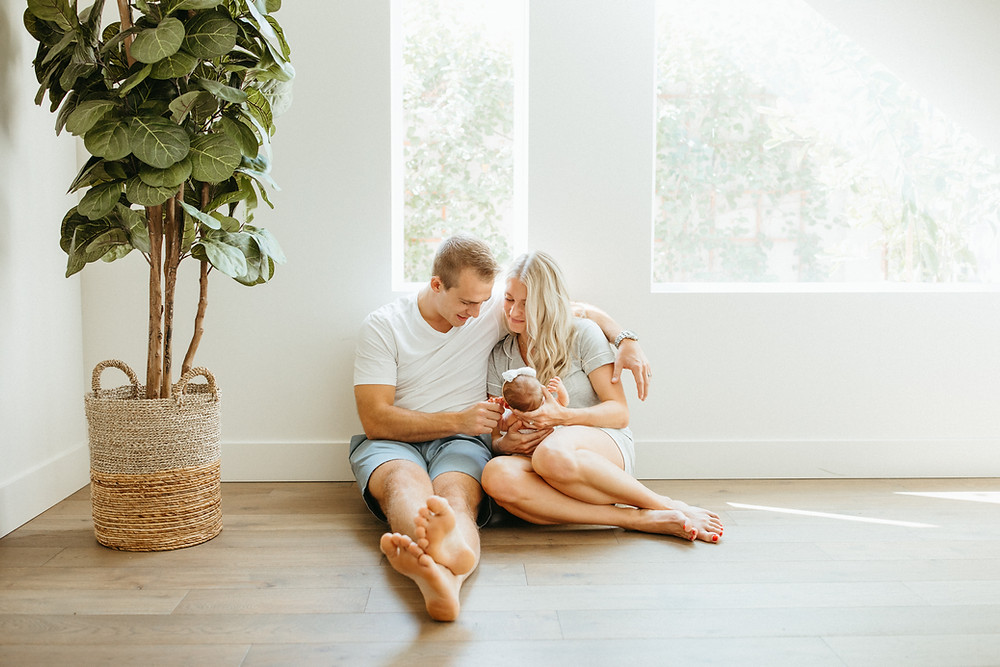 family holds baby for newborn lifestyle portrait session