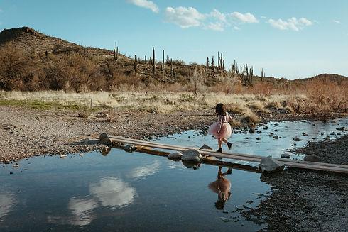 child runs in nature for family portrait