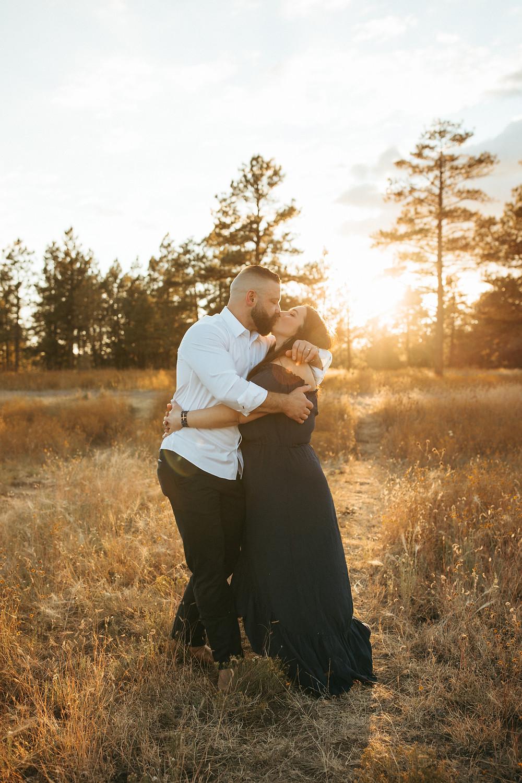 couple kiss for family photographer in Buffalo Park