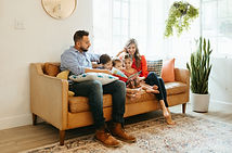 image of family reading on couch captured by phoenix family photographer