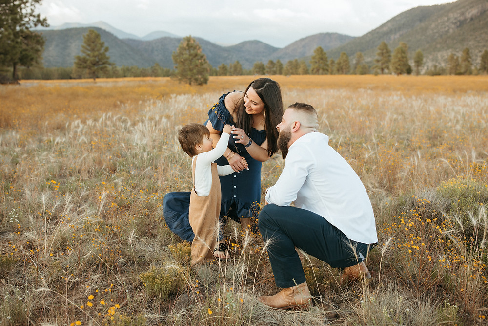 family plays in Flagstaff field for Arizona photography session