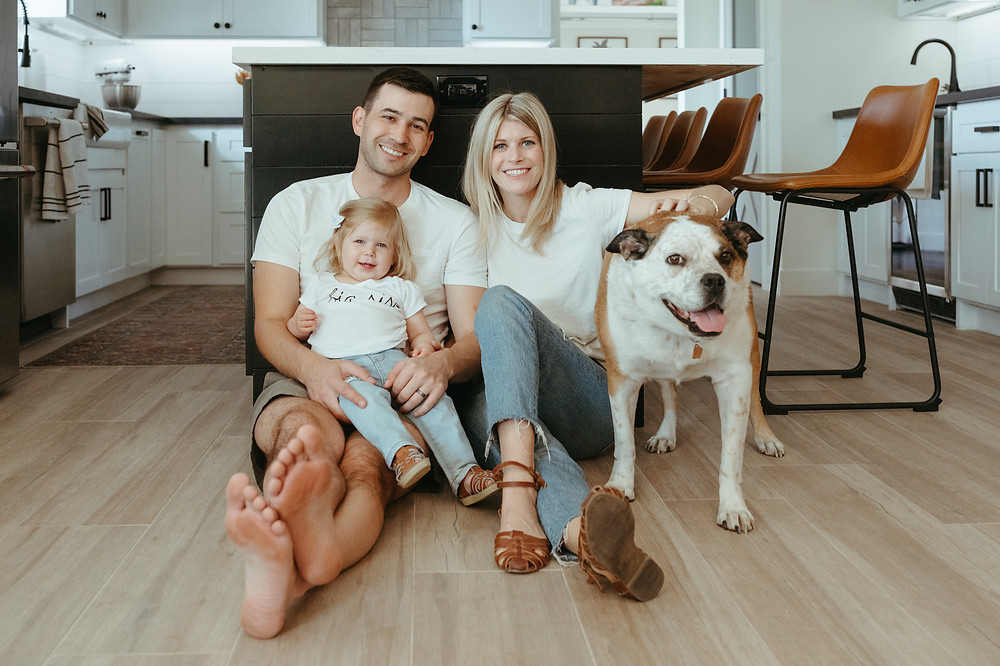 family poses with dog in Arcadia home for lifestyle portraits