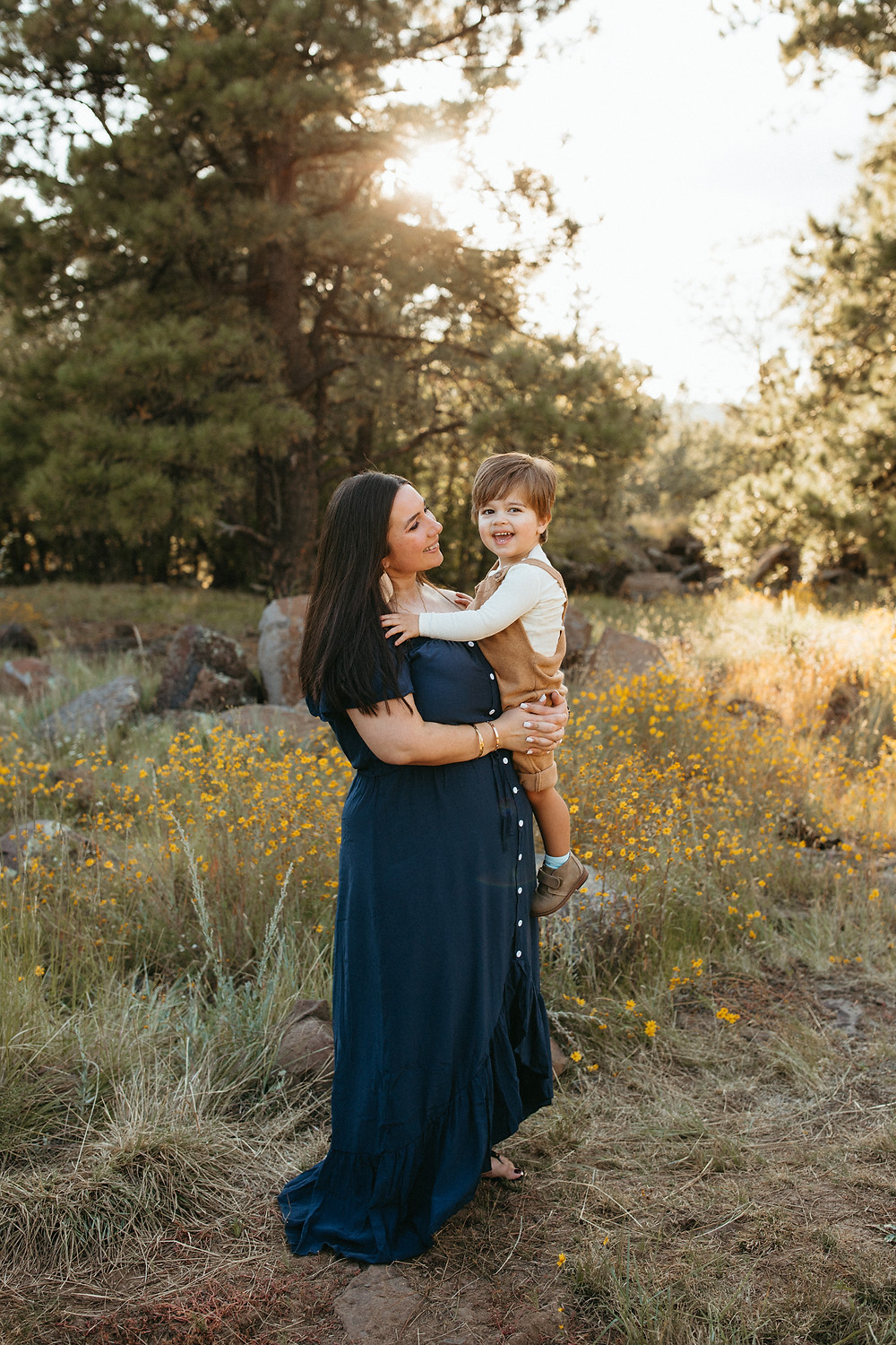 mother embraces child in Flagstaff park for family photography session