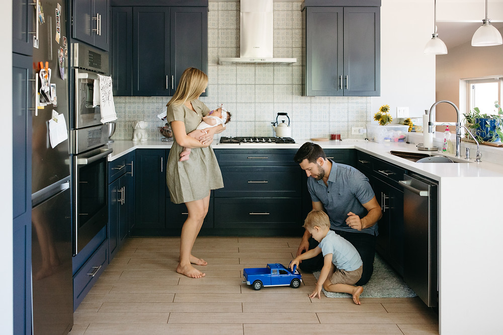 couple and kids play in Phoenix kitchen for family portraits