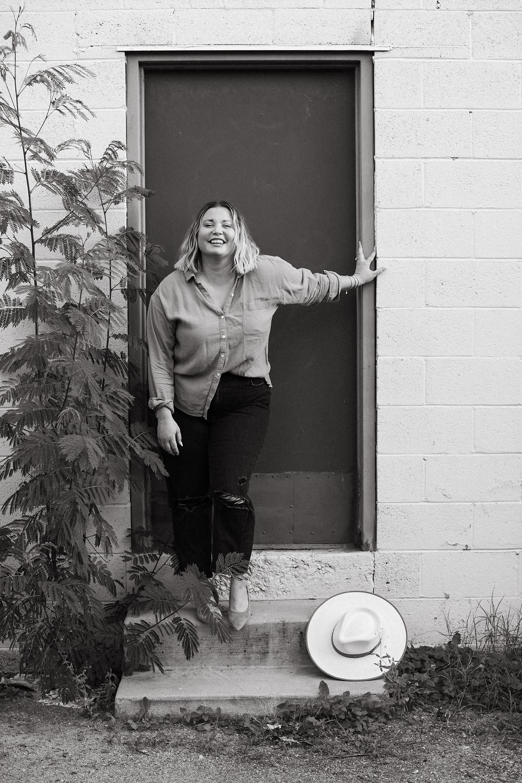 confident woman posing for personal brand portrait