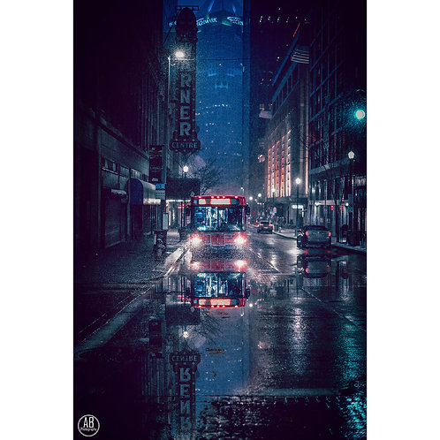 Photo taken downtown Pittsburgh featuring the reflection of a Port Authority bus during a wet winter in Pittsburgh.