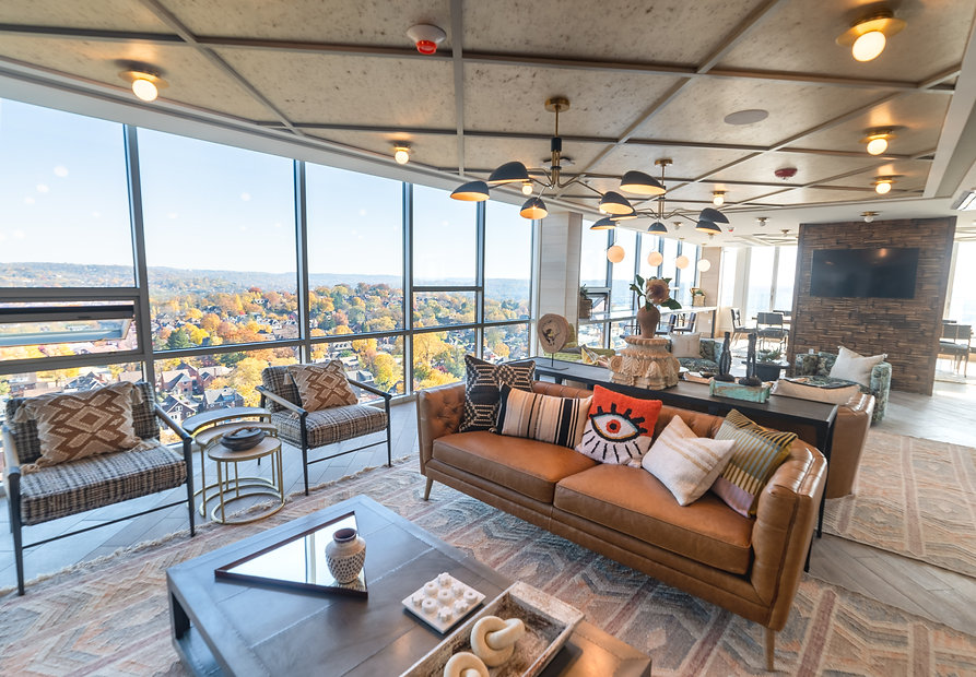 Pent House views of Pittsburgh featuring ceiling to floor windows located at Highlight House Apartments