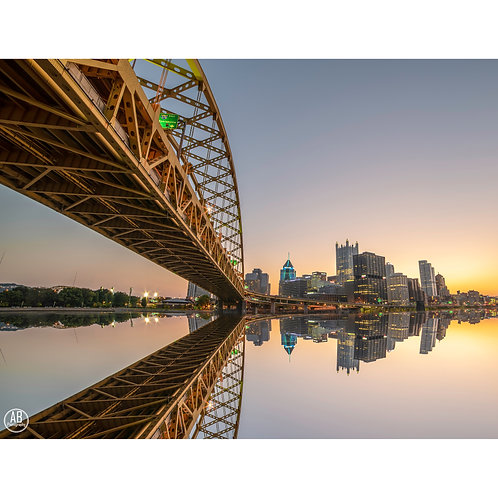 Photo of downtown Pittsburgh from below the Fort Pitt Bridge featuring a reflection off the Monongahela River.