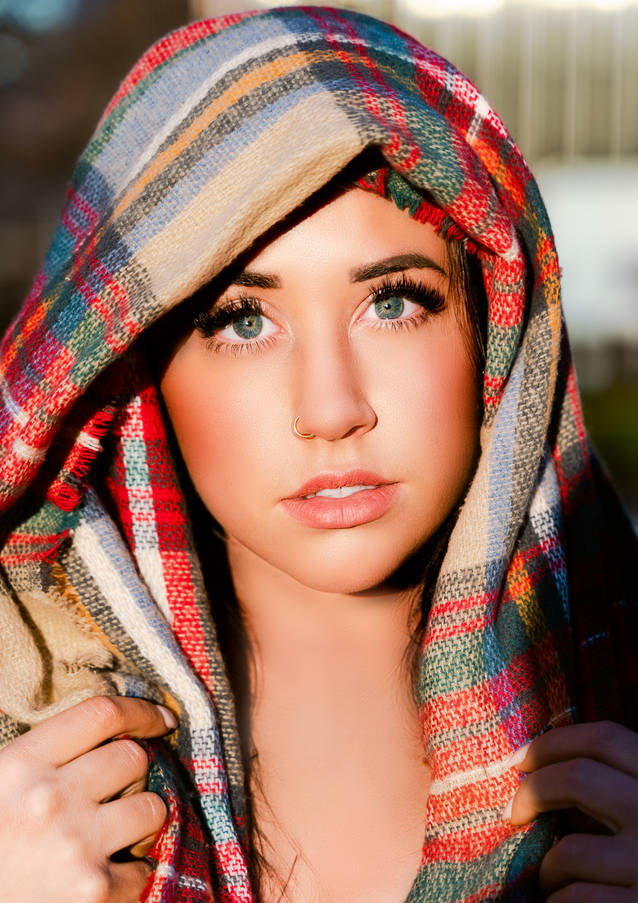 Close up portrait of a woman with a scarf