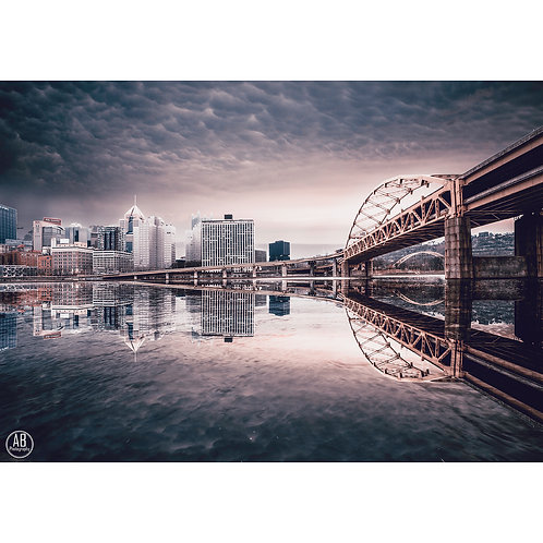 Reflection photo of Pittsburgh from the North Shore featuring the Fort Duquesne Bridge.