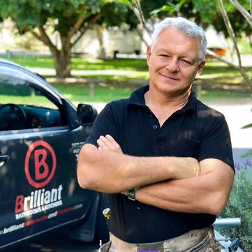 Silvio Testa is standing near his vehicle from Brilliant Bathrooms and Kitchens