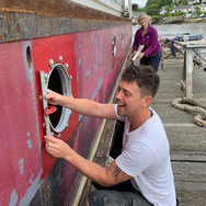 KATE AND JOSH PUTTING IN PORT HOLES STAR