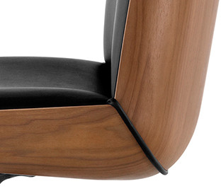 The shell's contour is based on compound curves found in nature that were impossible to express in wood—until recent advances in veneer molding.