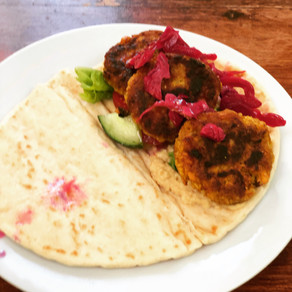 falafel flatbread with hummus & pickled red cabbage