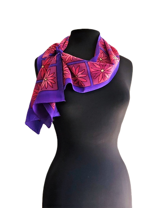 hand painted silk crepe de chine scarf with a graphic daisy motif on a predominantly purple and red measuring 8x54