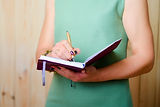 Woman writes in a notebook her observati