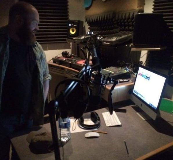 Novice radio DJ in a small studio